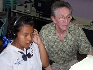 Student & Board Member Roger Parent receive instructions in use of English Language Software, Koh Yao Witiya School.