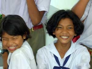 Two Students Laughing with World Dignity, Inc. Visitors